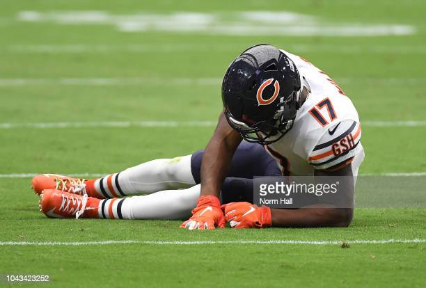 Anthony Miller of the Chicago Bears lays on the turf after being tackled by Bene Benwikere of the Arizona Cardinals during the first quarter at State...