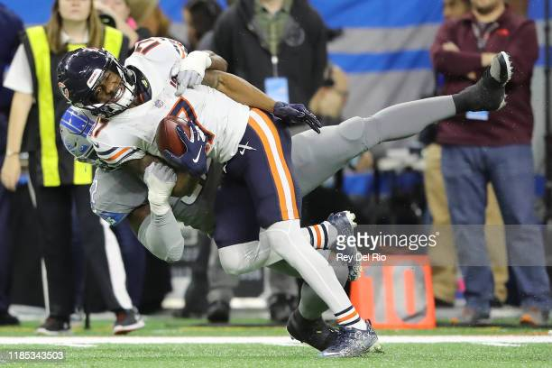Anthony Miller of the Chicago Bears makes a catch in the fourth quarter of the game and taken down by Christian Jones of the Detroit Lions at Ford...