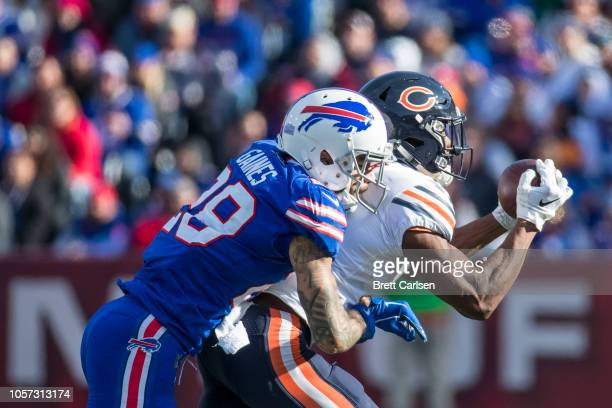 Anthony Miller of the Chicago Bears makes a reception as Phillip Gaines of the Buffalo Bills tackles during the second quarter at New Era Field on...