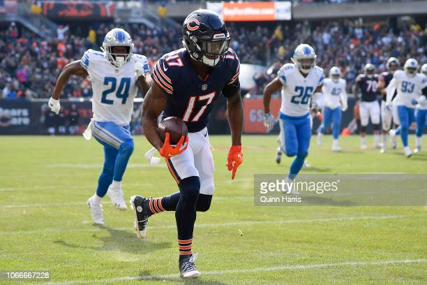 Anthony Miller of the Chicago Bears runs in for a touchdown against the Detroit Lions at Soldier Field on November 11 2018 in Chicago Illinois