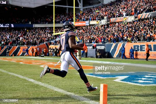 Anthony Miller of the Chicago Bears runs the football into the endzone for a touchdown against the Detroit Lions in the second quarter at Soldier...