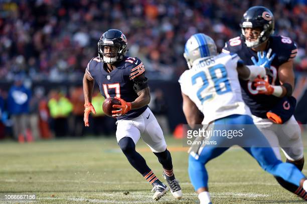 Anthony Miller of the Chicago Bears runs with the ball behind the block of Trey Burton of the Chicago Bears on Quandre Diggs of the Detroit Lions at...