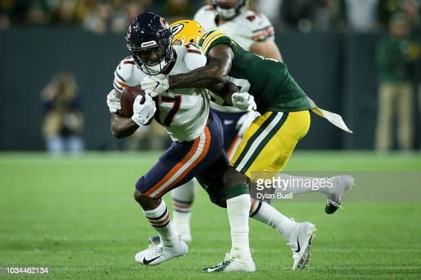 Anthony Miller of the Chicago Bears runs with the ball while being chased by Kentrell Brice of the Green Bay Packers in the fourth quarter at Lambeau...