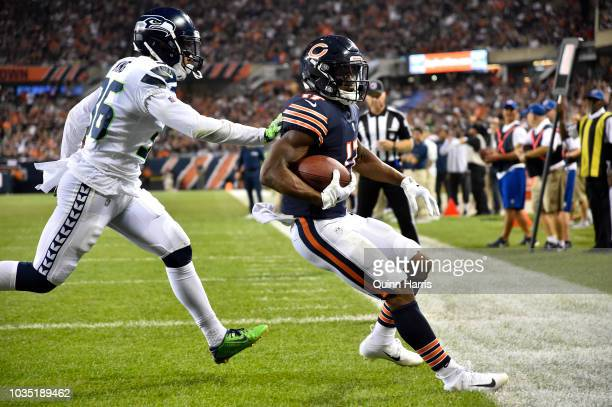 Anthony Miller of the Chicago Bears scores a touchdown against Akeem King of the Seattle Seahawks in the fourth quarter at Soldier Field on September...