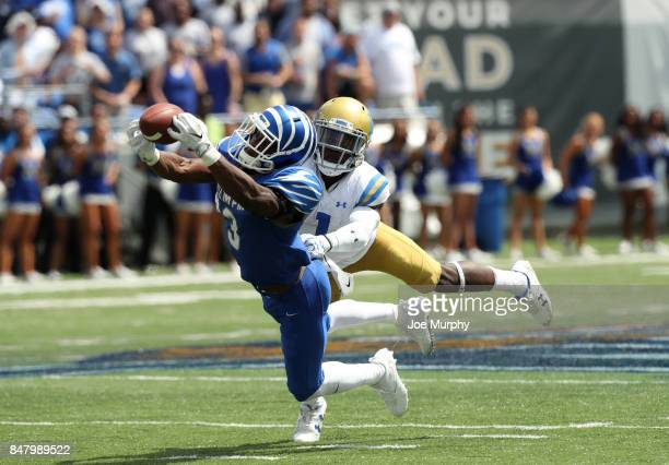 Anthony Miller of the Memphis Tigers catches a pass against Darnay Holmes of the UCLA Bruins on September 16 2017 at Liberty Bowl Memorial Stadium in...