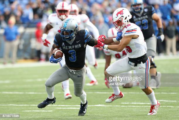 Anthony Miller of the Memphis Tigers runs after the catch against Jordan Wyatt of the SMU Mustangs on November 18 2017 at Liberty Bowl Memorial...