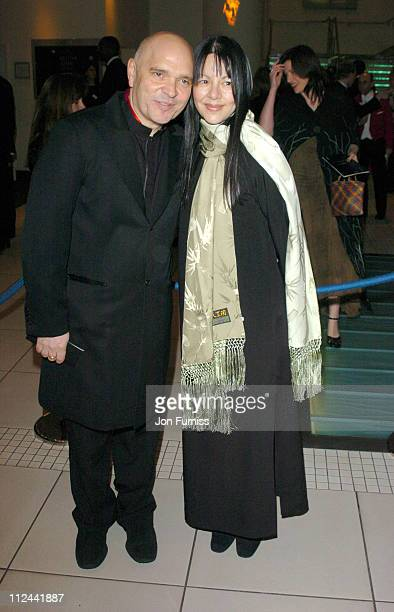 Anthony Minghella and Carolyn Choa during 2004 BAFTA Awards Inside Arrivals at The Odeon Leicester Square in London United Kingdom