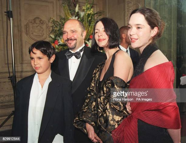 Anthony Minghella director of The English Patient and his wife Carolyn Choa arrive with their family at the Royal Albert Hall London for the BAFTA...