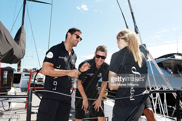 Anthony Minichello Michael Clarke Erin Molan and Kurtley Beale aboard Perpetual LOYAL as it prepares to depart from Rose Bay Marina on December 26...