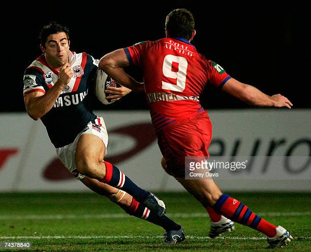 Anthony Minichello of the Rooster evades the defence of Danny Bederus of the Knights during the round 12 NRL match between the Sydney Roosters and...