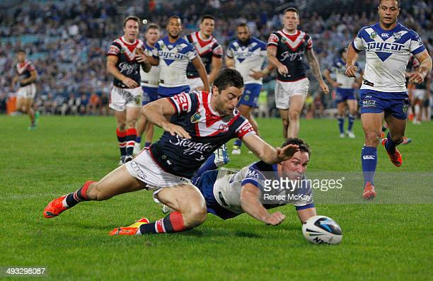 Anthony Minichiello beats Josh Jackson to the ball as he scores a try for the Rooster during the round 11 NRL match between the CanterburyBankstown...