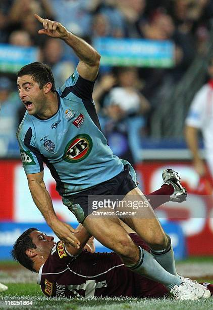 Anthony Minichiello of the Blues celebrates scoring a try during game two of the ARL State of Origin series between the New South Wales Blues and the...