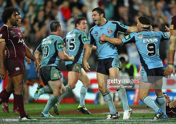 Anthony Minichiello of the Blues celebrates scoring a try with team mate Michael Ennis during game two of the ARL State of Origin series between the...