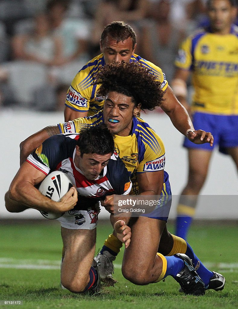 Anthony Minichiello of the Roosters is tackled by Pele Peletelese of the Eels during the NRL trial match between the Sydney Roosters and the Parramatta Eels at Bluetongue Stadium on February 27, 2010 in Gosford, Australia.