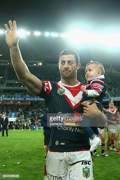 Anthony Minichiello of the Roosters thanks the crowd holding is daughter after winning the round 26 NRL match between the Sydney Roosters and the...
