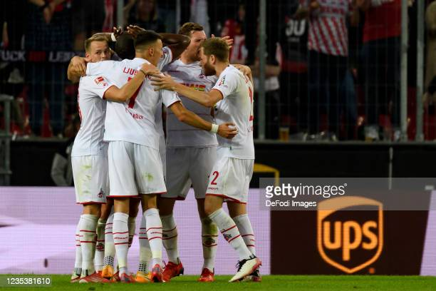 Anthony Modeste of 1. FC Koeln celebrates after scoring his team's first goal during the Bundesliga match between 1. FC Koeln and RB Leipzig at...