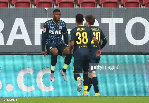 Anthony Modeste of 1. FC Koeln celebrates with his team mates after scoring his team's first goal during the Bundesliga match between FC Augsburg and...