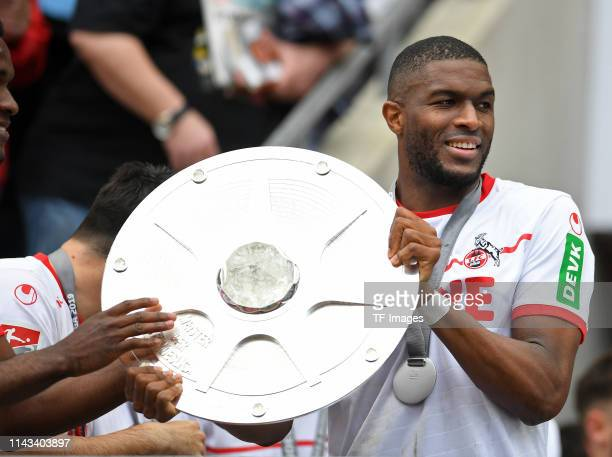 Anthony Modeste of 1 FC Koeln celebrates with the championship shield after the Second Bundesliga match between 1 FC Koeln and SSV Jahn Regensburg at...