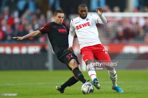 Anthony Modeste of 1. FC Koeln is challenged by Raphael Framberger of FC Augsburg during the Bundesliga match between 1. FC Koeln and FC Augsburg at...