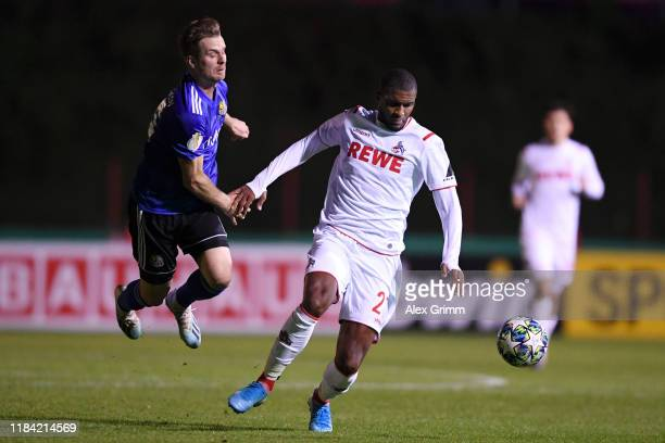 Anthony Modeste of 1. FC Koeln is challenged by Sebastian Jacob of 1 FC. Saarbruecken during the DFB Cup second round match between 1. FC...