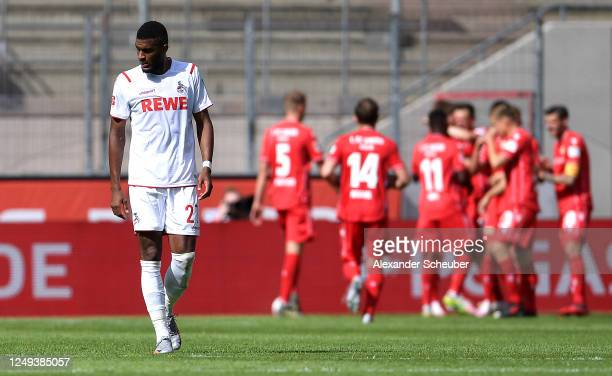 Anthony Modeste of 1. FC Koeln reacts as Christian Gentner of 1.FC Union Berlin celebrates with his team mates after scoring his team's second goal...