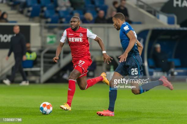 Anthony Modeste of 1.FC Koeln and Kevin Akpoguma of TSG 1899 Hoffenheim battle for the ball during the Bundesliga match between TSG Hoffenheim and 1....
