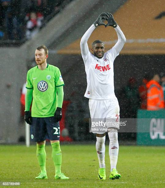Anthony Modeste of Cologne celebrates scoring the 1:0 goal while Maximilian Arnold of Wolfsburg looks disappointed during the Bundesliga match...