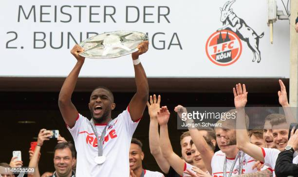 Anthony Modeste of Cologne lifts the trophy after the Second Bundesliga match between 1 FC Koeln and SSV Jahn Regensburg at RheinEnergieStadion on...