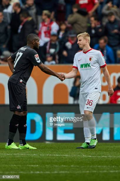 Anthony Modeste of Colonge shakes hands with i Martin Hinteregger of Augsburg during the Bundesliga match between FC Augsburg and 1 FC Koeln at WWK...