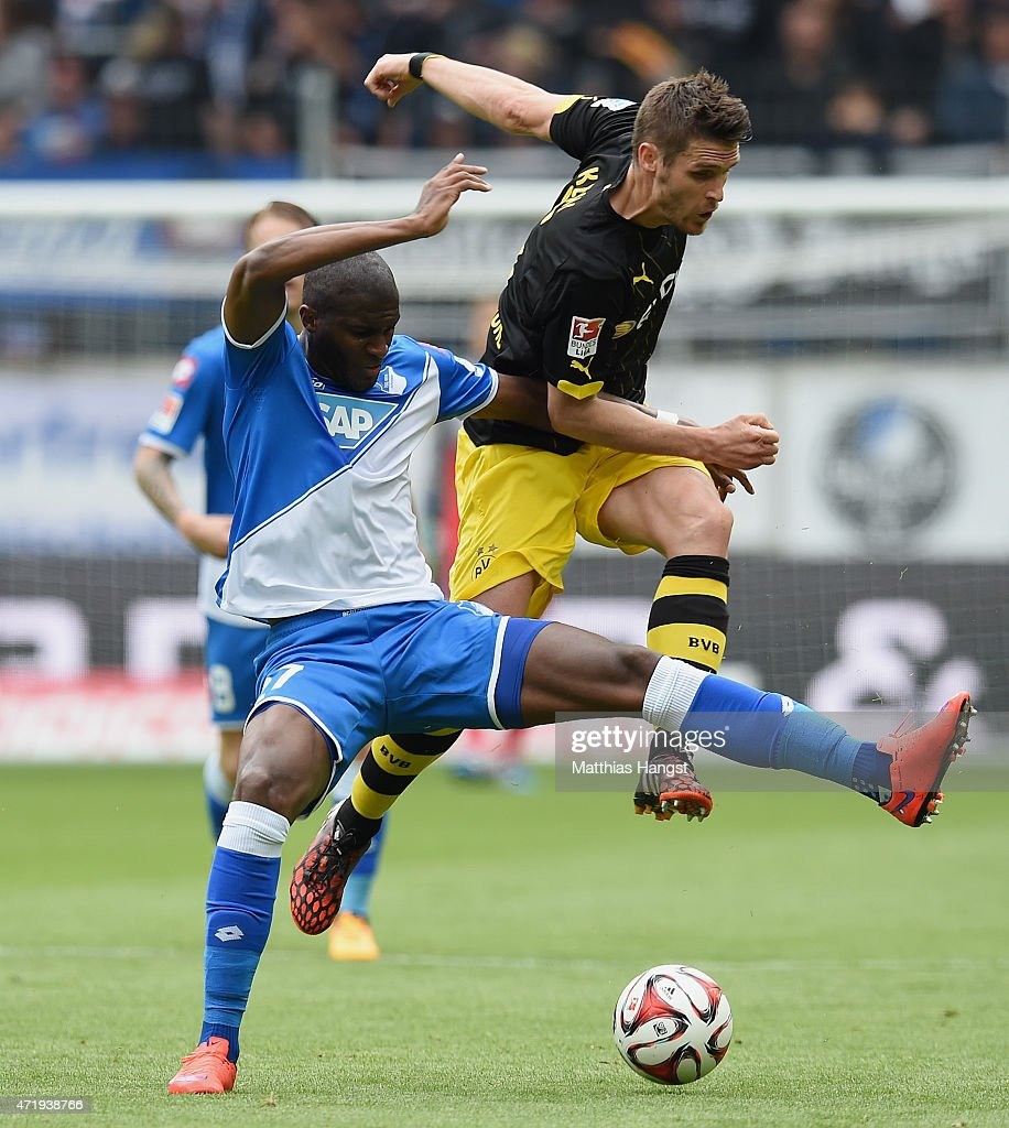 Anthony Modeste (L) of Hoffenheim and Sebastian Kehl (R) of Dortmund compete for the ball during the Bundesliga match between 1899 Hoffenheim and Borussia Dortmund at Wirsol Rhein-Neckar-Arena on May 2, 2015 in Sinsheim, Germany.