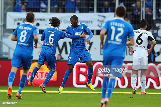 Anthony Modeste of Hoffenheim celebrates his team's third goal with team mate Sebastian Rudy during the Bundesliga match between 1899 Hoffenheim and...