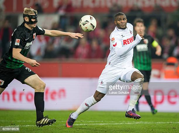 Anthony Modeste of Koeln and Martin Hinteregger of Augsburg in action during the Bundesliga match between 1 FC Koeln and FC Augsburg at...