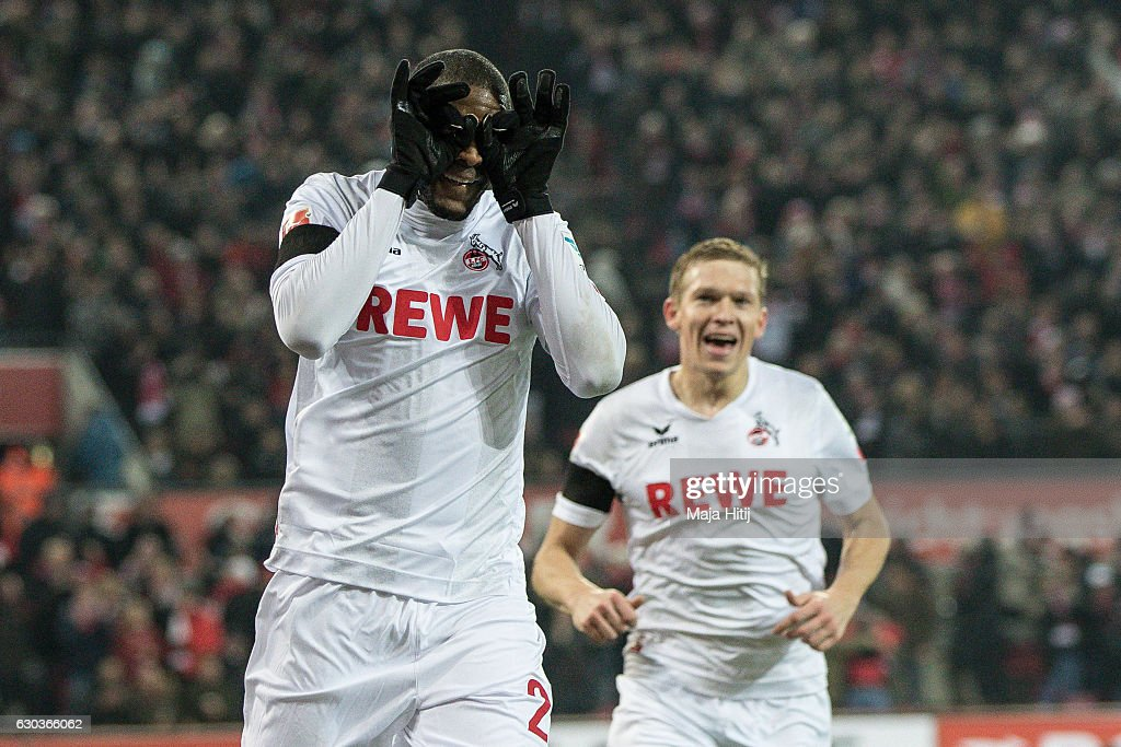 Anthony Modeste (L) of Koeln celebrates after scoring a goal to make it 1-0 with Artjoms Rudnevs of Koeln during the Bundesliga match between 1. FC Koeln and Bayer 04 Leverkusen at RheinEnergieStadion on December 21, 2016 in Cologne, Germany.