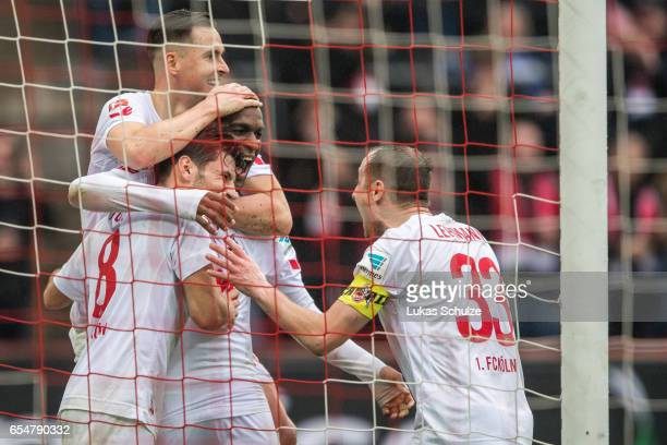 Anthony Modeste of Koeln celebrates his teams second goal with Milos Jojic Christian Clemens and Matthias Lehmann during the Bundesliga match between...