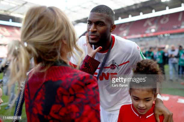 Anthony Modeste of Koeln celebrates with his family after the Second Bundesliga match between 1. FC Koeln and SSV Jahn Regensburg at...
