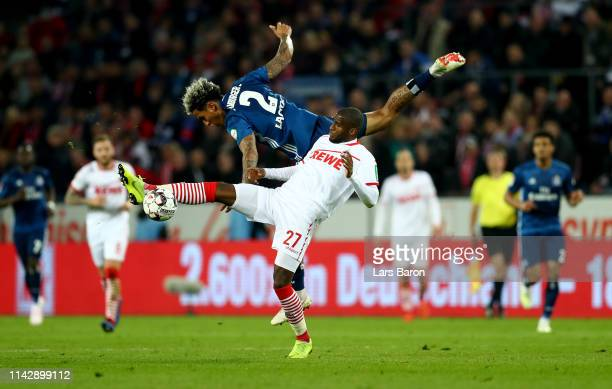 Anthony Modeste of Koeln challenges Leo Lacroix of Hamburg during the Second Bundesliga match between 1 FC Koeln and Hamburger SV at...