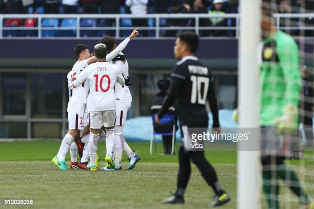 Anthony Modeste of Tianjin Quanjian celebrates with team mates after scoring his team's first goal during the 2018 AFC Champions League qualifying...