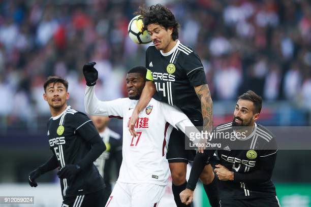 Anthony Modeste of Tianjin Quanjian competes the ball with Carlos De Murga of CeresNegros during the 2018 AFC Champions League qualifying match...