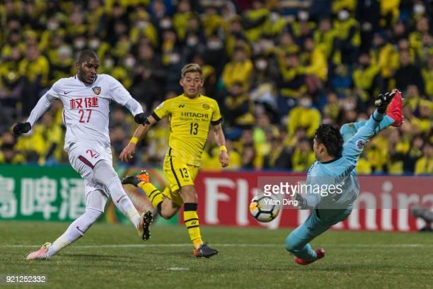 Anthony Modeste of Tianjin Quanjian takes a shot against Kosuke Nakamura of Kashiwa Reysol during the AFC Champions League match between Kasshiwa...