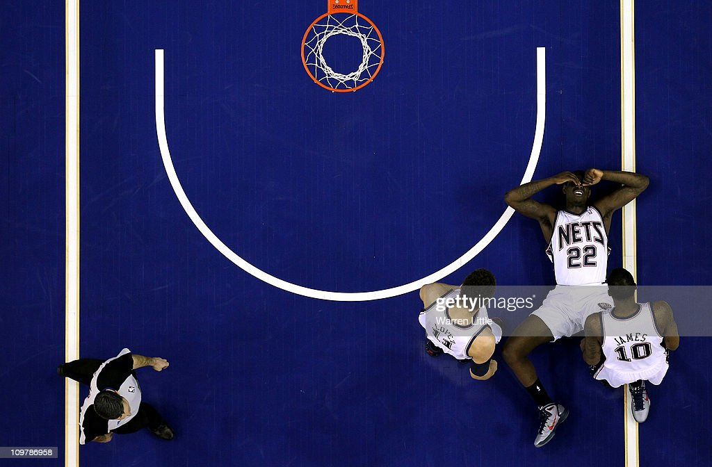 Anthony Morrow #22 lies on the court after a fall during the NBA match between New Jersey Nets and the Toronto Raptors at the O2 Arena on March 4, 2011 in London, England.