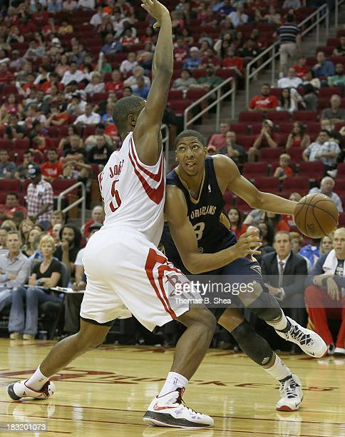 Anthony Morrow of the New Orleans Pelicans dribbles around Terrence Jones of the Houston Rockets in a preseason NBA game on October 5 2013 at Toyota...