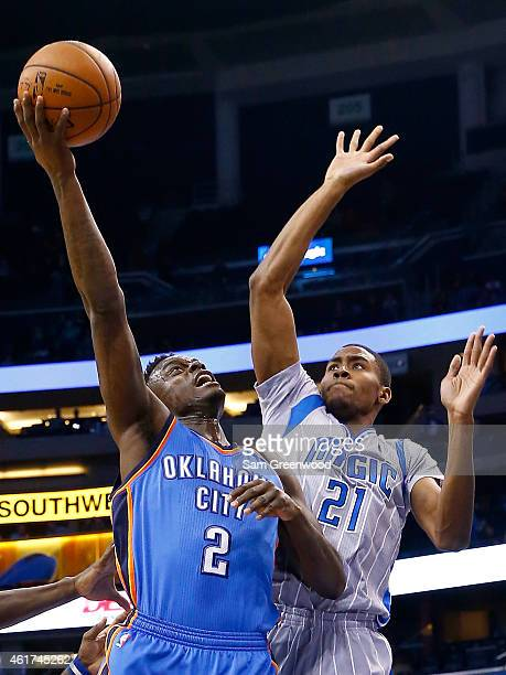 Anthony Morrow of the Oklahoma City Thunder attempts a shot over Maurice Harkless of the Orlando Magic during the game at Amway Center on January 18...