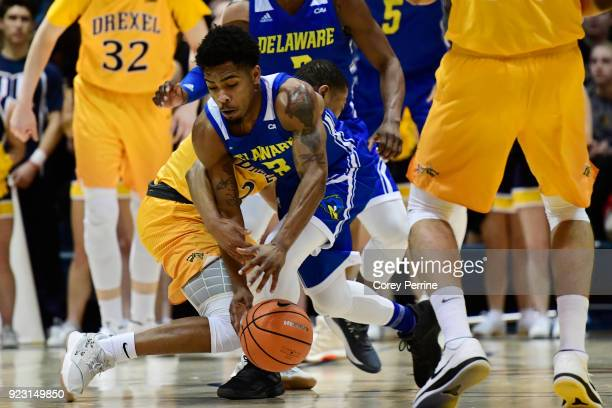Anthony Mosley of the Delaware Fightin Blue Hens collides with Troy Harper of the Drexel Dragons during the first half at the Daskalakis Athletic...