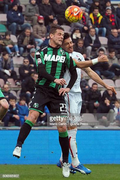 Anthony Mounier of Bologba FC competes the ball with Marcello Gazzola of US Sassuolo Calcio during the Serie A match between US Sassuolo Calcio and...
