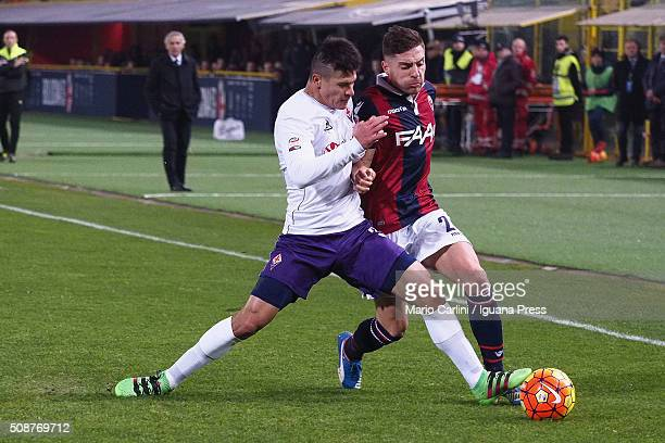 Anthony Mounier of Bologna FC competes the ball with Facundo Roncaglia of ACF Fiorentina during the Serie A match between Bologna FC and ACF...