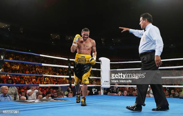 Anthony Mundine celebrates his sixthround TKO victory over Shane Mosley during the WBA International super welterweight title bout between Anthony...