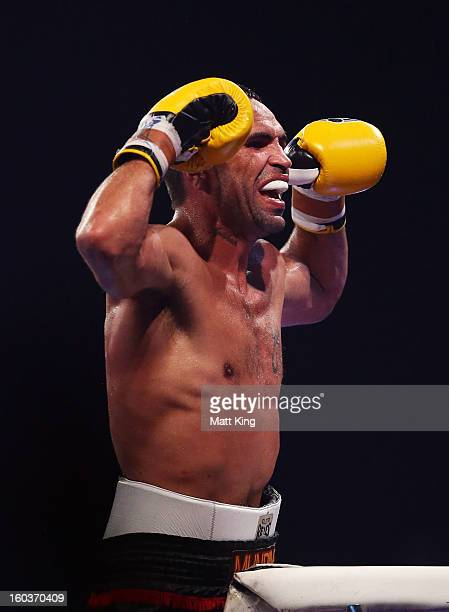 Anthony Mundine gestures towards the crowd after the IBF Middleweight Title bout between Anthony Mundine and Daniel Geale at Sydney Entertainment...