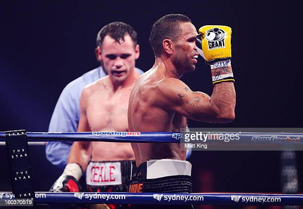 Anthony Mundine gestures towards the crowd as Daniel Geale looks on after the IBF Middleweight Title bout between Anthony Mundine and Daniel Geale at...