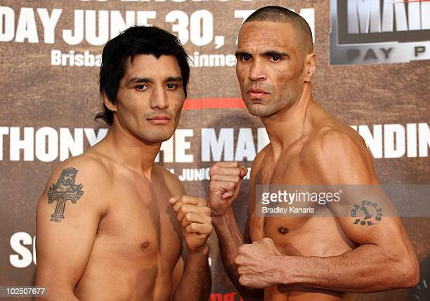 Anthony Mundine of Australia and Carlos Jerez of Argentina pose for the cameras at the official WeighIn at the Brisbane Entertainment Centre on June...