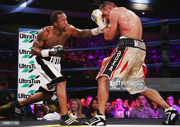 Anthony Mundine of Australia and is hit by Charles Hatley of the USA during their bout at The Melbourne Convention and Exhibition Centre on November...